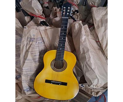 Mua đàn guitar thông chỉ